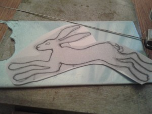 Hare design ready to pierce out from the silver sheet