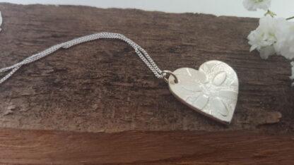Flowery silver heart pendant