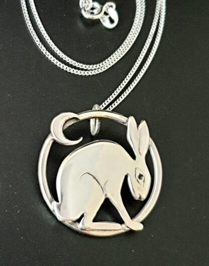 Pensive Hare with Moon Pendant