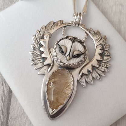 Blodeuwedd 1: A silver owl with the body made from an opal stone and the feathers in silver