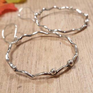 Wavy Silver hoop earring